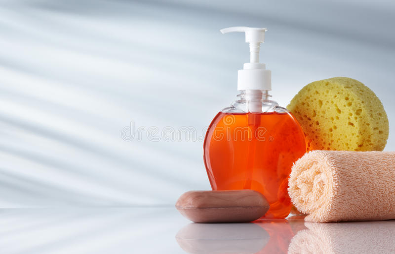 Toiletries. Assorted toiletries on grey background with copy space stock photo
