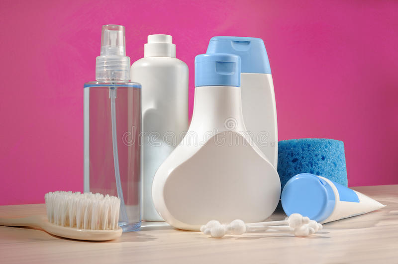 Toiletries baby detail. Blue items and pink background royalty free stock image