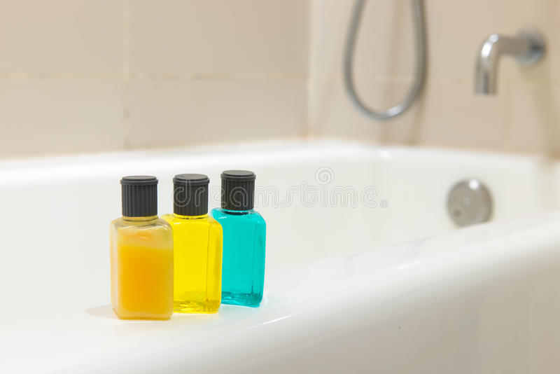 Toiletries in bathroom. Set of toiletries on bathtub in a hotel bathroom royalty free stock photo