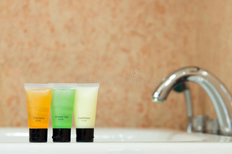 Toiletries in bathroom. Set of toiletries placed at sink in the bathroom stock image