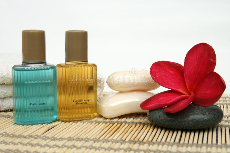 Toiletries set. Shampoo,bath foam, towel, flower, etc that can be used as a symbol of toiletries set royalty free stock photography