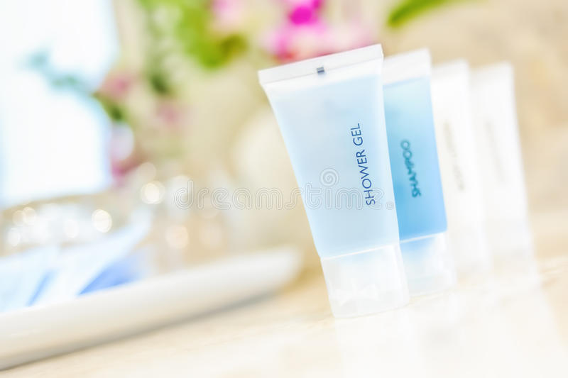 Toiletries tube. In a luxury hotel, shower gel, shampoo, hair conditioner, body lotion stock images