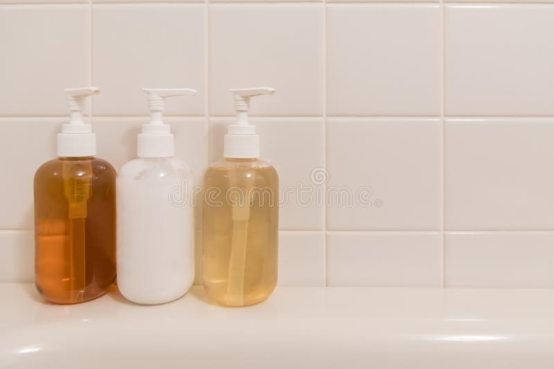 Toiletry bag with travel toiletries, small plastic bottles of hygiene products and soap, Hotel Guest Room Supplies.  royalty free stock photos