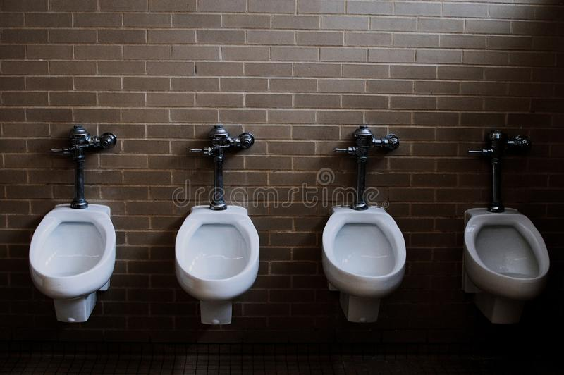 Toilets in the bathroom, Missouri. St Louis is a city located in United States of America. Toilets in the bathroom of St. Louis street, Missouri. St Louis is a royalty free stock images