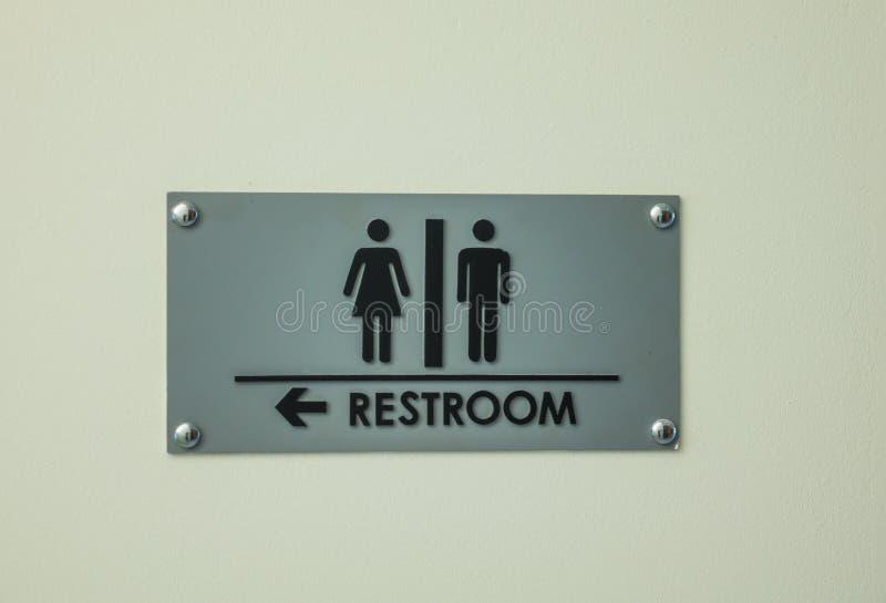 Toiletteken op grungemuur royalty-vrije stock afbeelding