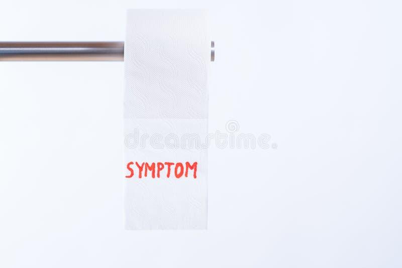 Toilettenpapier mit Aufschrift Symptom in der roten Farbe stockfoto