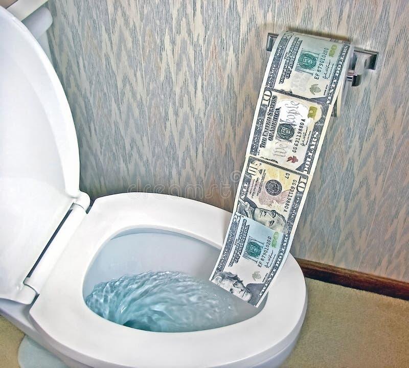 Toilettenpapiergeld in der weißen Toilette lizenzfreies stockfoto