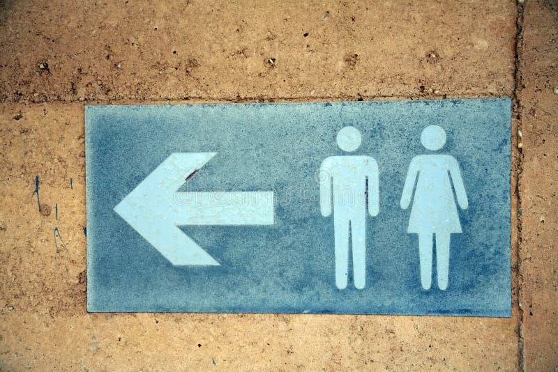 Toilettenrichtung Signage stockfotos