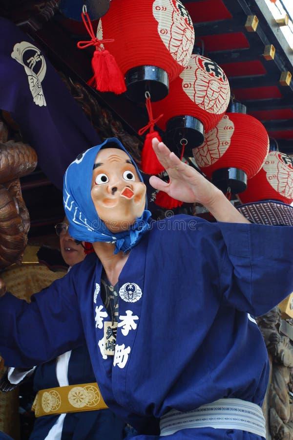 TOKIO, HACHIOJI - 10 DE AGOSTO: Festival anual del verano Demostración de Hyottoko en Hachioji, Tokio el 10 de agosto de 2005 imagen de archivo libre de regalías