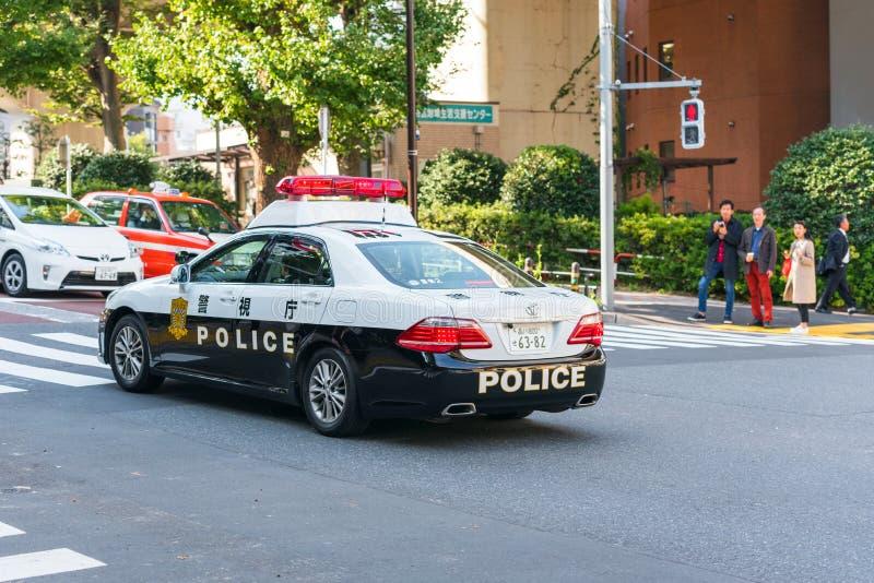 TOKIO JAPONIA, PAŹDZIERNIK, - 31, 2017: Samochód policyjny na miasto ulicie kopia zdjęcie royalty free