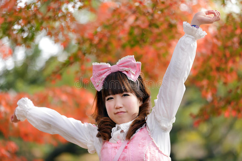 Tokyo autumn and lolita. Japanese lolita portrait in park during fall season, Tokyo royalty free stock images