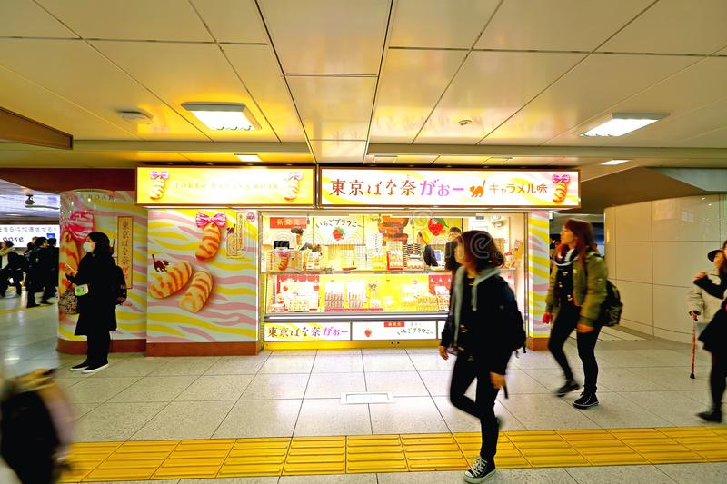 Japan: shops in train station. Tokyo Banana shop in 1 of the many train stations in Tokyo. Crowd walking by royalty free stock photo