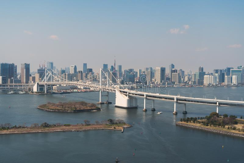 Tokyo Bay with a view of the Tokyo skyline and Rainbow Bridge in tokyo, Japan stock photos