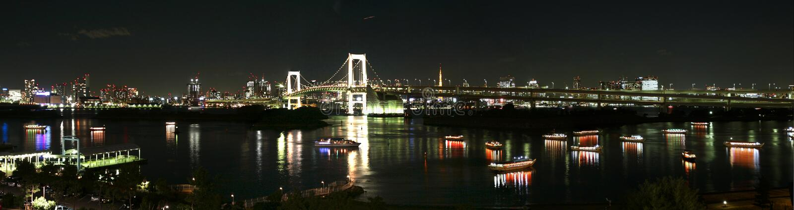 Tokyo city at night. Toky city in Odaiba and the rainbow bridge and tokyo tower in background royalty free stock images
