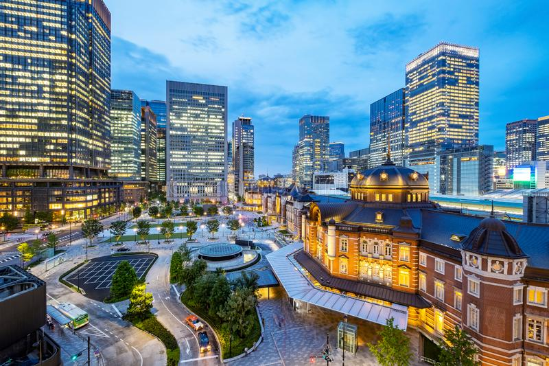 Tokyo city skyline at railway station surround by modern highrise building at twilight time. stock photo