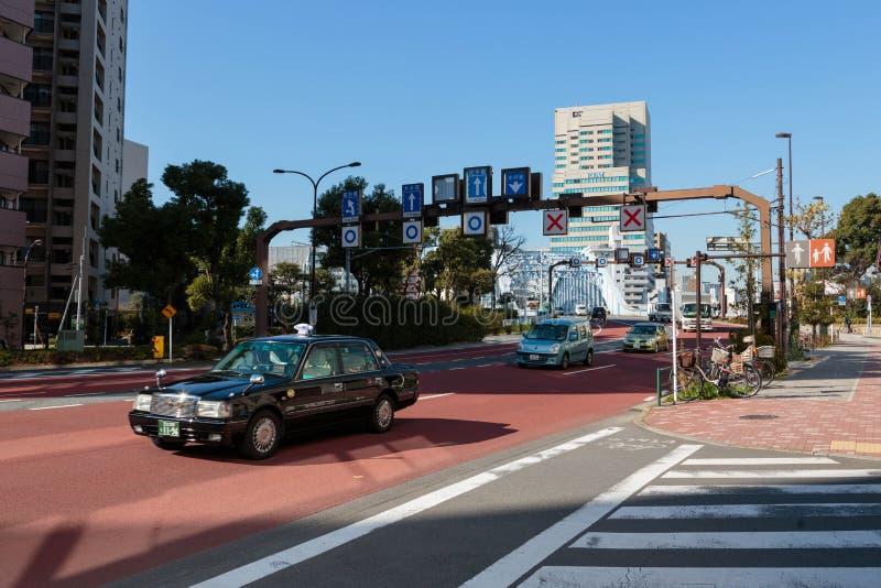 Tokyo gatasikt framme av den Eitai bron royaltyfri fotografi