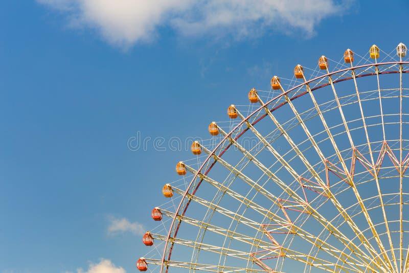 Tokyo giant ferris wheel against blue sky stock photo