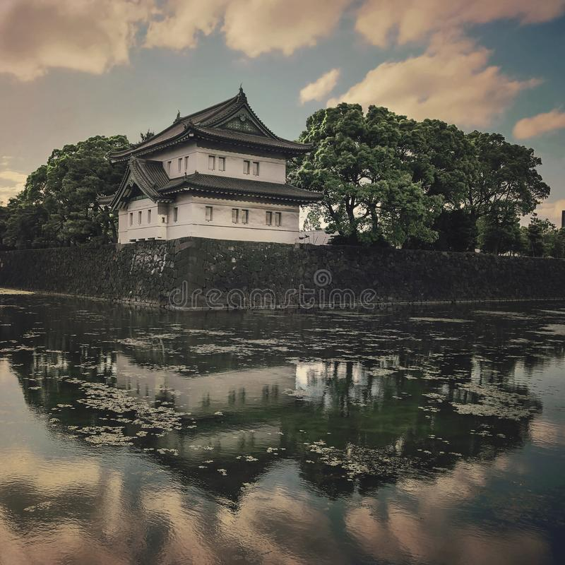 Tokyo Imperial Palace with sunset clouds reflected in the lake stock image