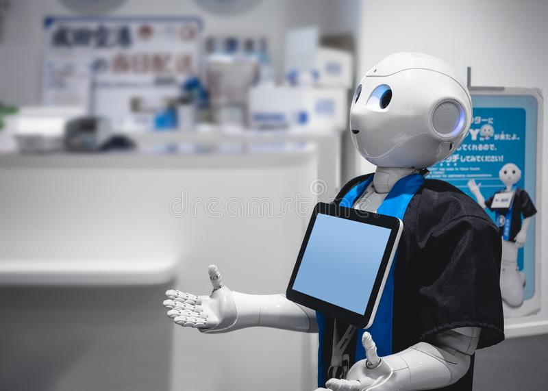 TOKYO, JAPAN - APR 13, 2018 : Pepper Robot Assistant Humanoid display Information screen Artificial intelligence technology stock image