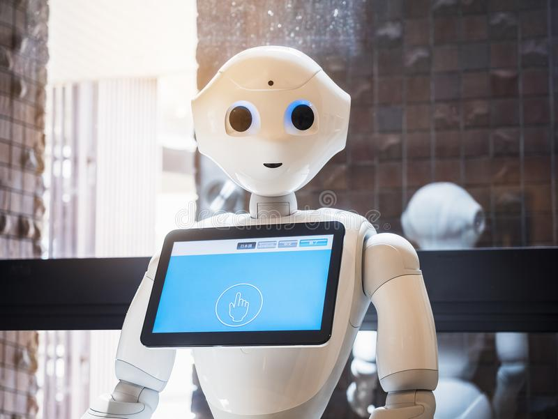 TOKYO JAPAN - APR 11, 2018 :Pepper Robot Assistant with Information screen Japan Humanoid technology. Communication royalty free stock photo