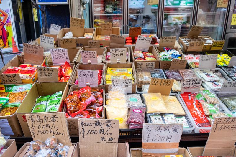 Tokyo, Japan - Aug 08 2017 : Retail shop on along the street with ingredient, snack, souvenir on paper box. With price tag royalty free stock photos