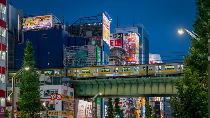 Akihabara Electric Town district in the evening with colorful lights and banners, Tokyo, Japan. Tokyo, Japan - August 2018: Akihabara Electric Town district in royalty free stock images