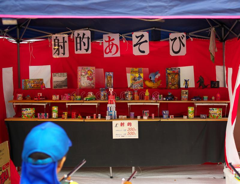 Target Shooting or shooting gallery or shateki at vendor stand stock image
