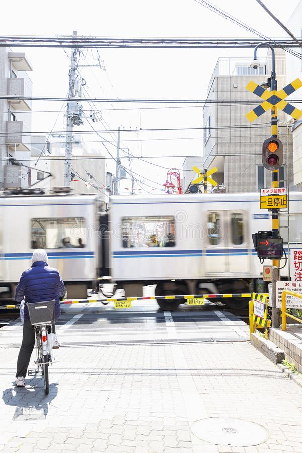 Tokyo, Japan, 04/04/2017: Crossing the railroad tracks in a metropolis. stock photos