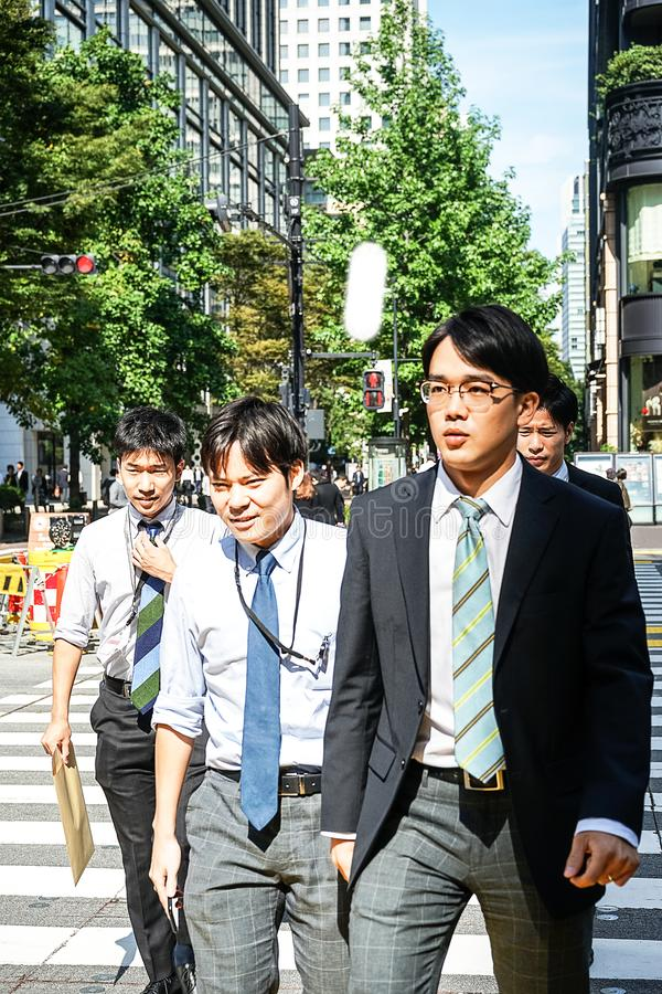 Tokyo, Japan 10.02.2018 crowd of citizens and tourists in business and casual clothes crossing street in popular Ginza district of stock images