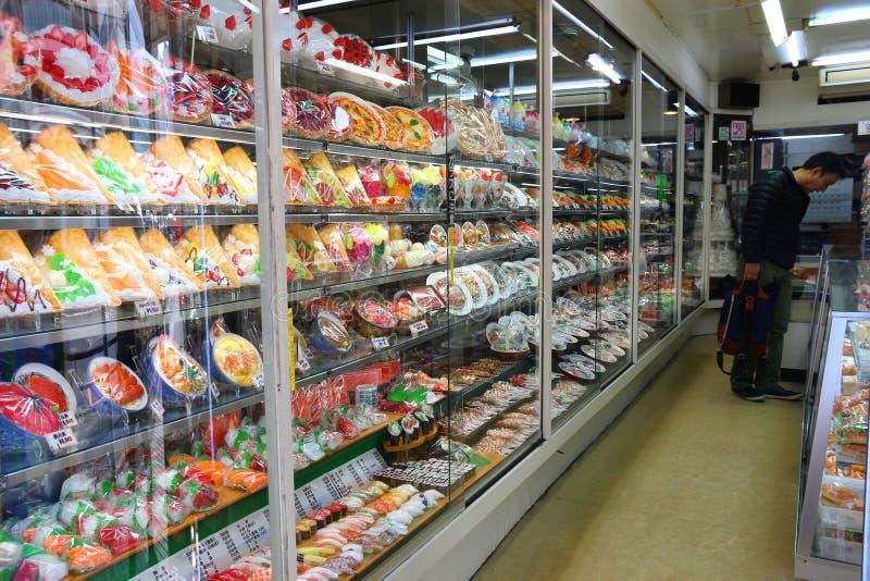 Plastic food replica. TOKYO, JAPAN - DECEMBER 4, 2016: Person visits plastic food replica store in Kappabashi, Asakusa in Tokyo, Japan. Kappabashi Street is stock photos
