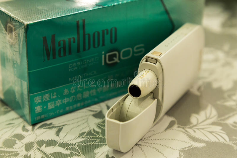 TOKYO, JAPAN - December 9, 2016: Phillip Morris International`s. Marlboro IQOS, a smokeless hybrid between analogs and electronic cigarettes stock photo