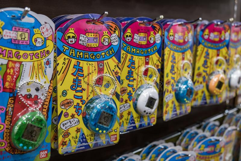 Tight shot of Tamagotchi electronic retro virtual pet from the nineties in blue and white. TOKYO, JAPAN - 12 FEB 2018: Tight shot of Tamagotchi electronic retro stock photo