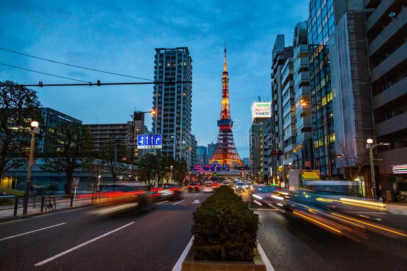 Tokyo Tower, a famous landmark of Japan, stands tall against late evening sky and Tokyo city lights with busy traffic stock image