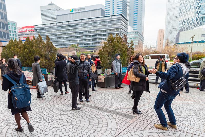 TOKYO, JAPAN - FEBRUARY 5, 2019: Tokyo Shinjuku Area with Smoking People. Smoking Area Outside. Japan. Tokyo Shinjuku Area with Smoking People. Smoking Area stock photography