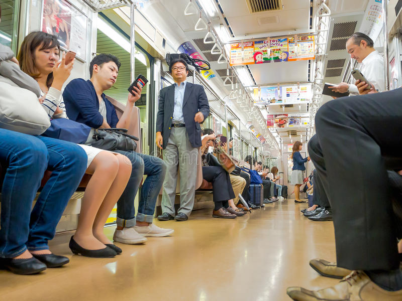 Tokyo, Japan - Jan 2, 2016. People sitting in a Yamanote train in Tokyo, Japan. The railway system in Japan has a high royalty free stock photo
