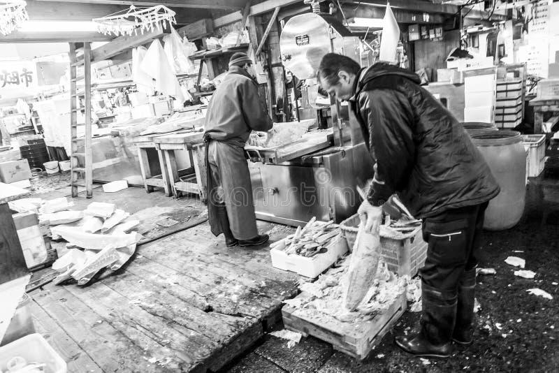 Tokyo, Japan - January 15, 2010: Early morning at Fish Market. Vendor cutting tuna at Tsukiji Fish Market stock photo
