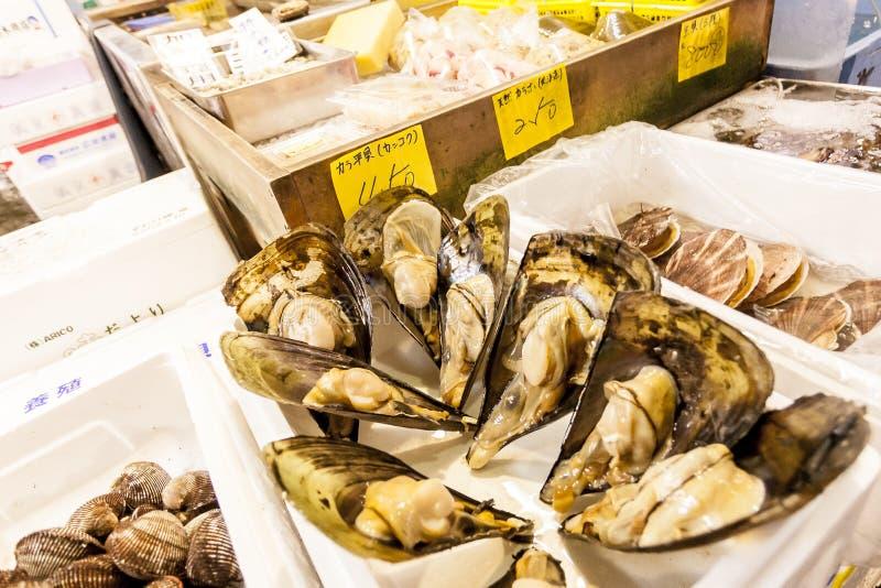 Tokyo, Japan - January 15, 2010: Early morning at Tsukiji Fish Market. The box with fresh seafood royalty free stock images