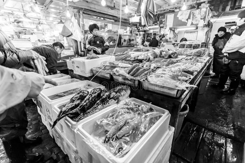 Tokyo, Japan - January 15, 2010: Early morning at Tsukiji Fish Market. The first customers buy fresh fish. Tokyo, Japan stock image