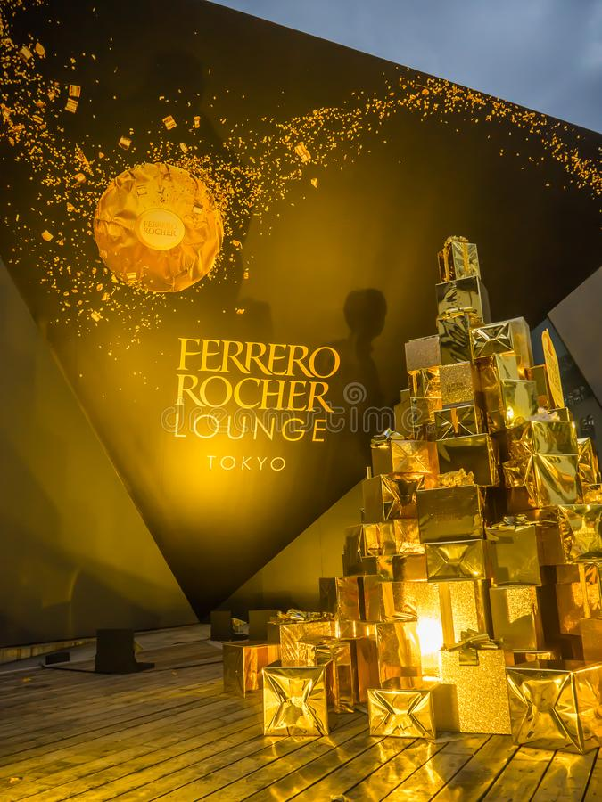 Tokyo, Japan - July 26, 2017: Close up of a beautiful tower of golden presents gifs, about ferrero rocher chocolate stock photos