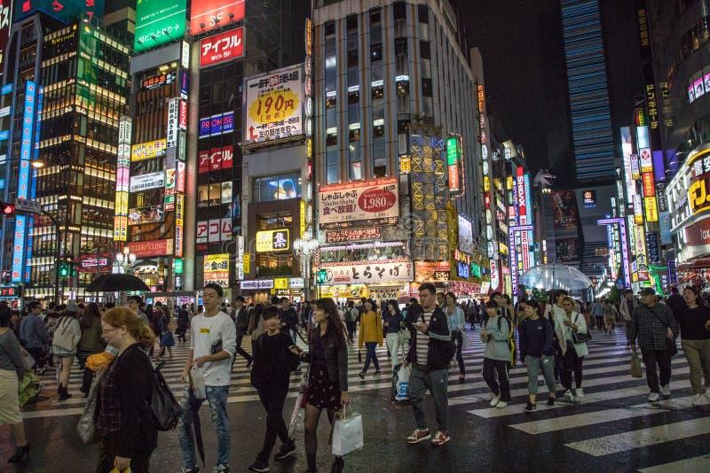 Japanese Street Photography. Shibuya and Shinjuku Night Life. People are walking beside the buildings. TOKYO/JAPAN - July 26, 2018 : Japanese Street Photography royalty free stock image