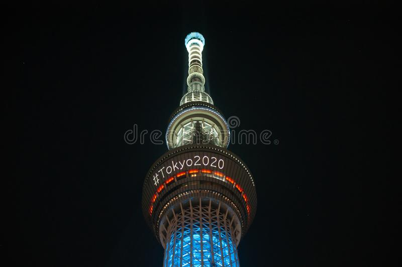 Tokyo, Japan - July 29, 2019: The skytree tower is illuminated at night announcing the olympics of Tokyo 2020 with a hashtag.  stock photo