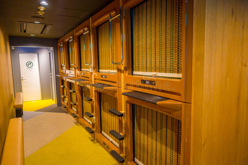 TOKYO, JAPAN JUNE 28 - 2017: Interior view of capsule hotel in city center. Capsule Hotels are less expensive structures royalty free stock photo