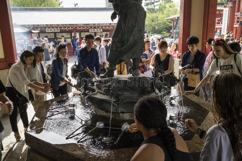 Tokyo - Japan, June 17, 2017; Purify hands and mouth at the temizuya, water pavilion, in front of Senso ji Temple in Asakusa royalty free stock photo