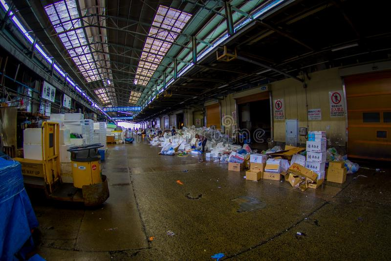 TOKYO, JAPAN JUNE 28 - 2017: Unidentified man working next to a pile of white boxes in Tsukiji Market is the biggest. Wholesale fish and seafood market in the royalty free stock image