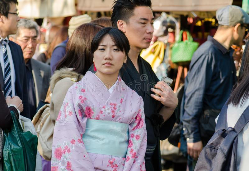 Japanese girl and boy  in traditional dress near the Sensoji Temple, Asakusa, Tokyo, Japan royalty free stock photos