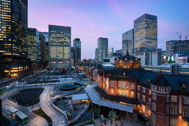 Tokyo, Japan at the Marunouchi business district and Tokyo railway station highrise building at twilight time in Japan. royalty free stock photos