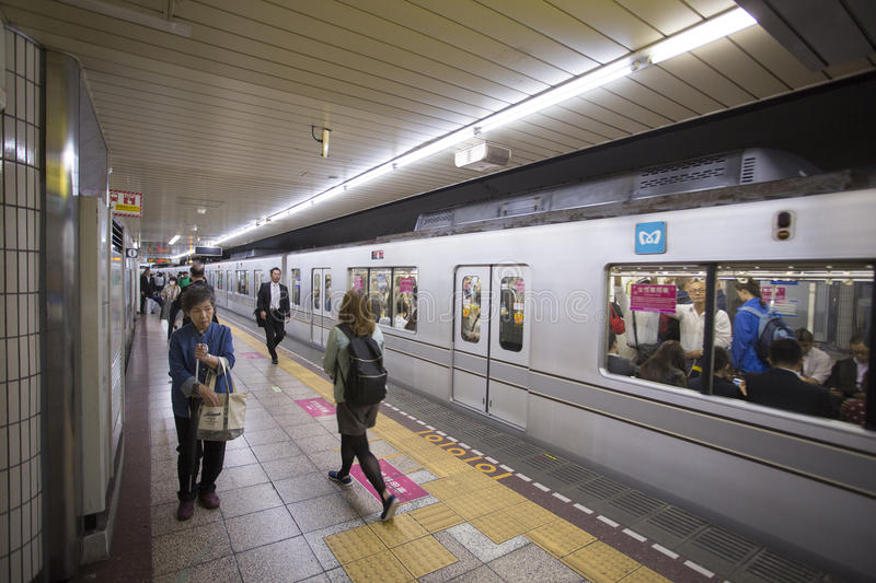 TOKYO, JAPAN - MAY 30, 2016 : Tokyo Metro subway. People walk and wait. Tokyo Metro subway is a popular mode of transportation in Tokyo for people to commute stock images
