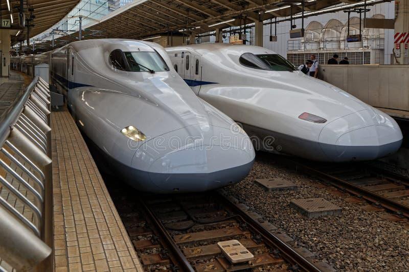 Two Shinkansen at quay in Tokyo station stock photos