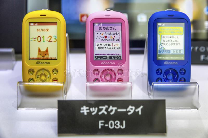 Tokyo, Japan, 04/08/2017. Multi-colored children`s models of mobile phones in the storefront in the store. Close-up stock images