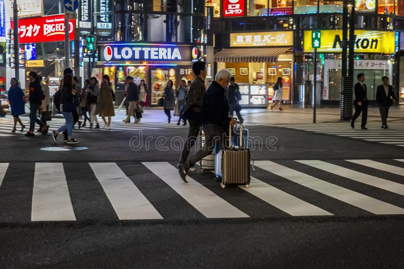 Tokyo, Japan, 04/08/2017: Night street of the metropolis. Horizontal stock images